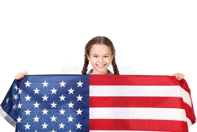 Ragazza che tiene una bandiera americana fotografia stock libera da diritti