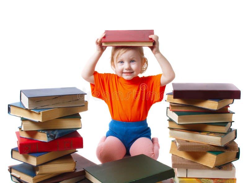 Download Ragazza con i libri immagine stock. Immagine di infanzia - 7315377