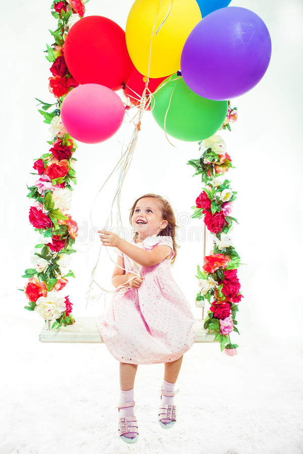 Ragazza con i palloni fotografie stock
