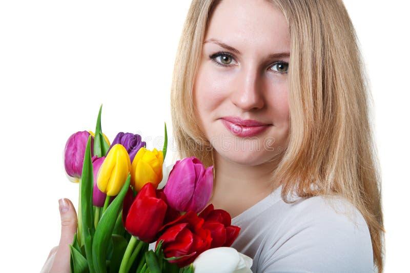 Ragazza con i tulipani fotografia stock
