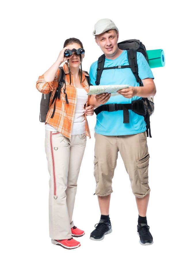 Ragazza con il binocolo e un uomo con i viaggiatori della mappa due immagine stock libera da diritti
