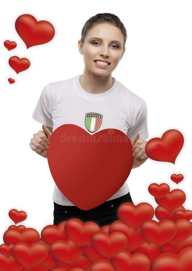 Ragazza con il giorno di biglietti di S. Valentino del cuore immagine stock