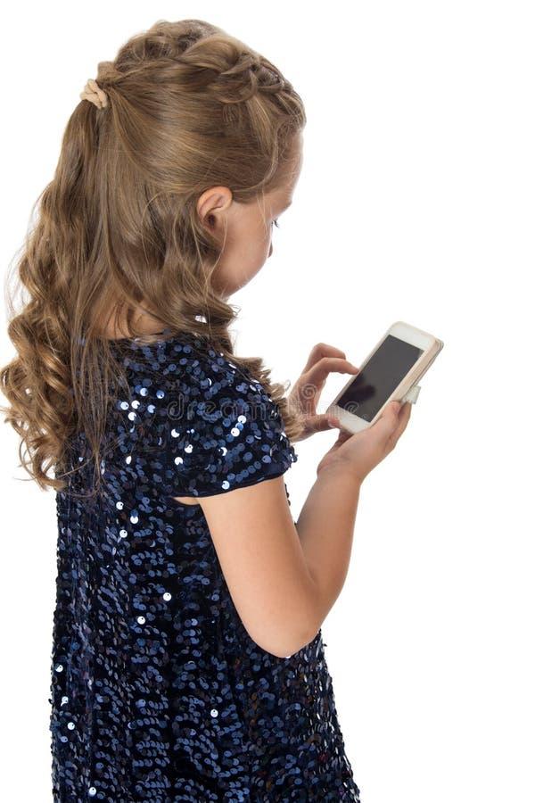 Ragazza con il telefono fotografia stock libera da diritti