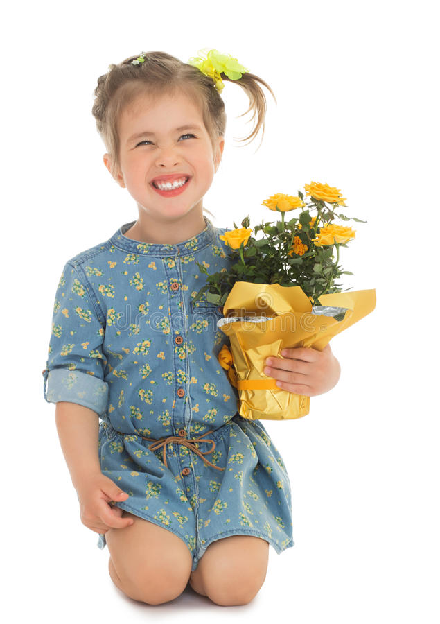 Ragazza con il vaso dei fiori fotografie stock libere da diritti