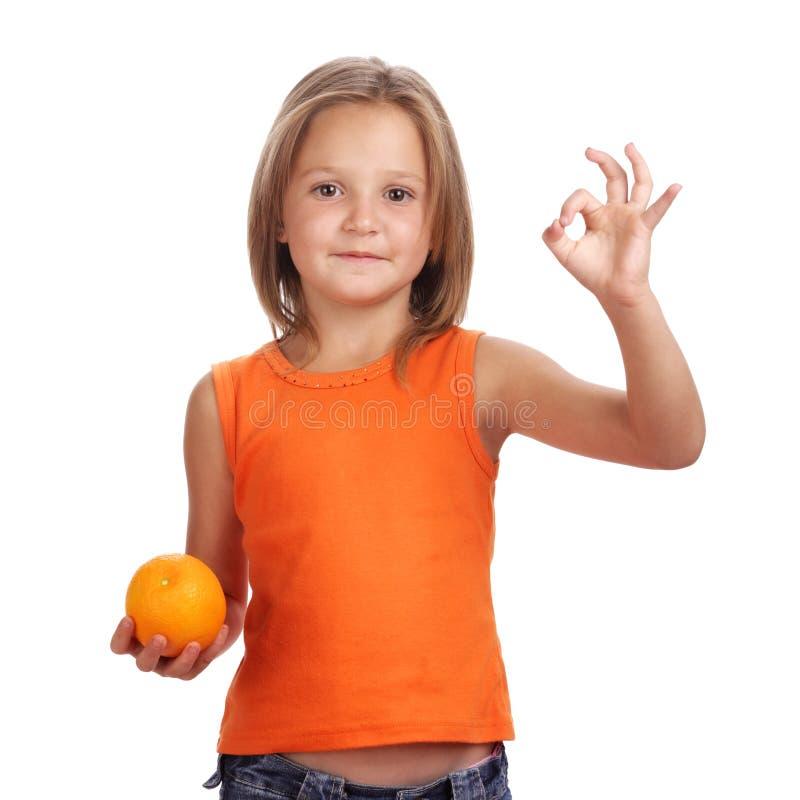 Ragazza con l'arancio immagini stock libere da diritti