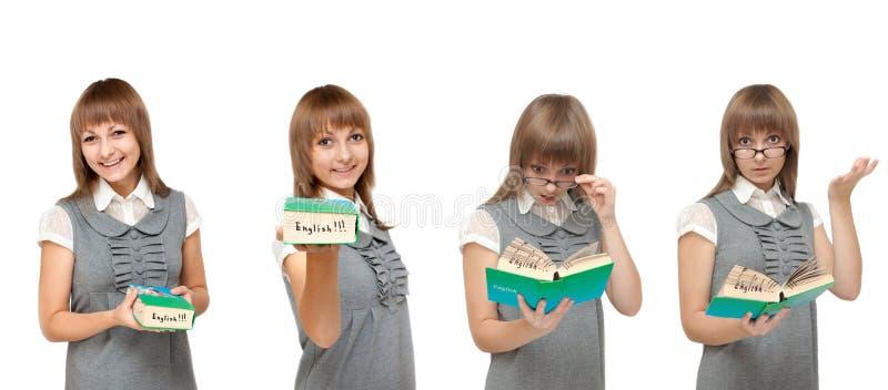 Ragazza con l'inglese del dizionario, emozioni fotografie stock