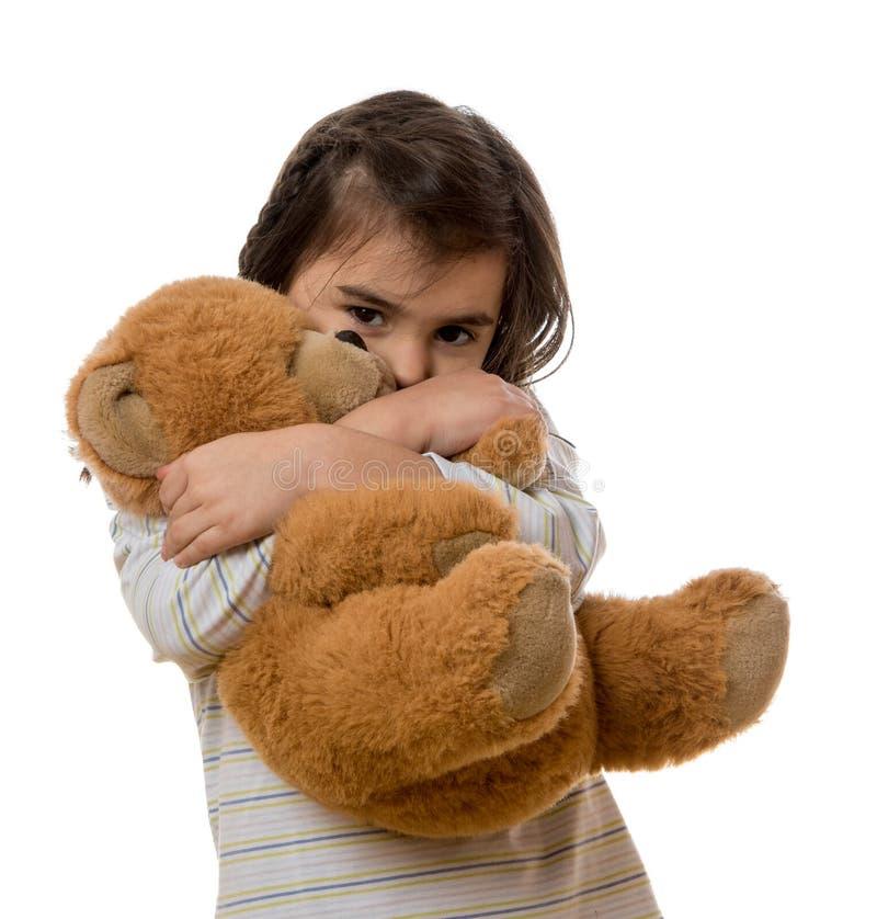 Ragazza con l'orso di orsacchiotto fotografia stock libera da diritti