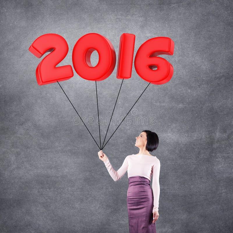 Ragazza con la data 2016 fotografia stock