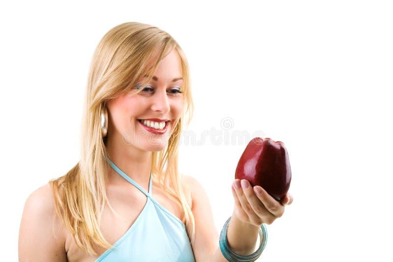 Ragazza con la mela fotografia stock