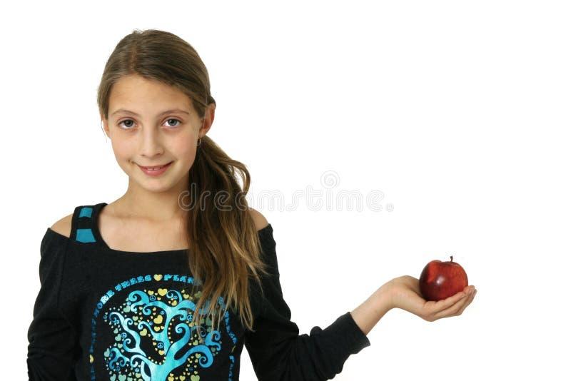Download Ragazza con la mela immagine stock. Immagine di bello - 7306145