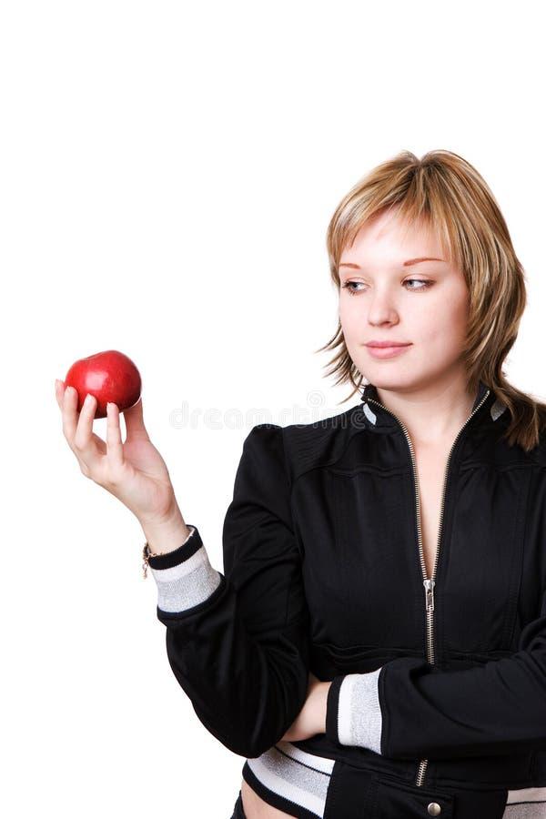 Ragazza con la mela rossa fotografie stock