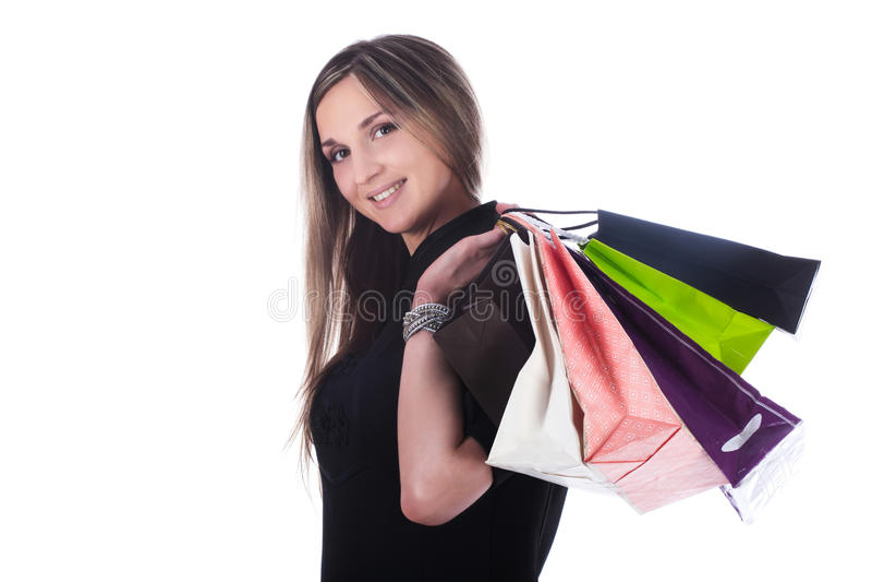Ragazza con le borse fotografia stock libera da diritti