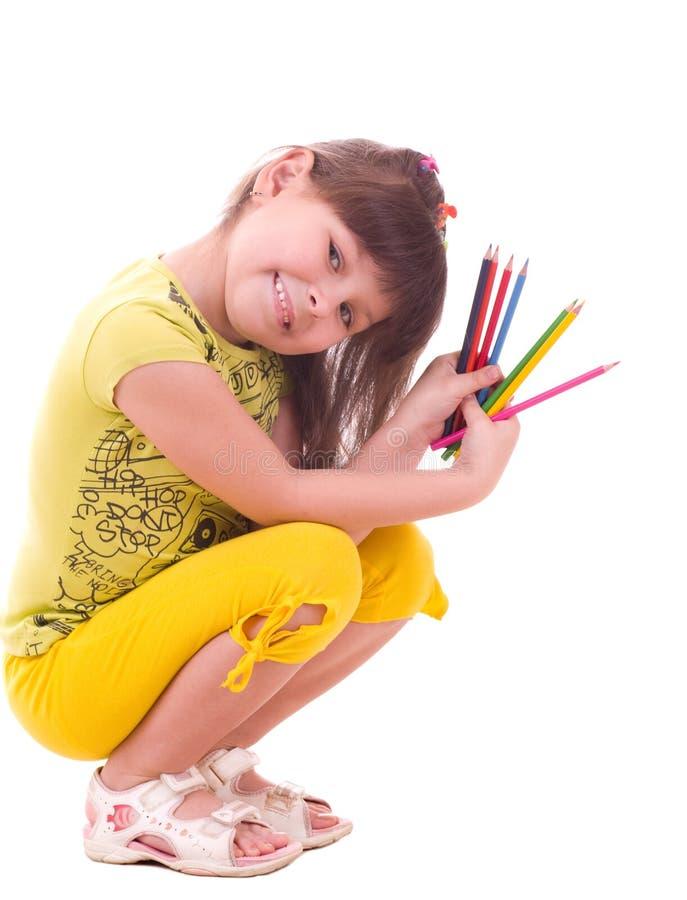 Ragazza con le matite di colore immagini stock