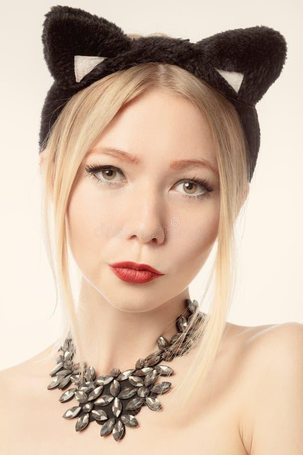 Ragazza con le orecchie di gatto fotografia stock