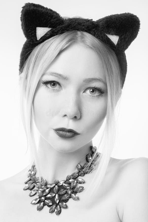 Ragazza con le orecchie di gatto immagini stock libere da diritti