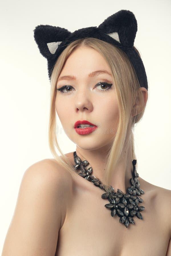 Ragazza con le orecchie di gatto fotografie stock libere da diritti
