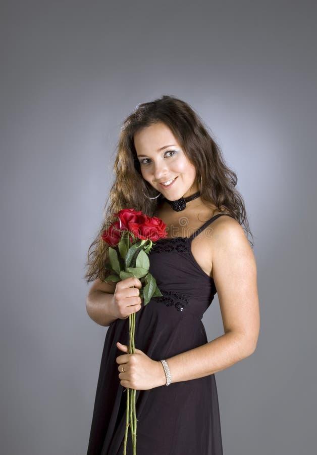 Ragazza con le rose. immagine stock libera da diritti