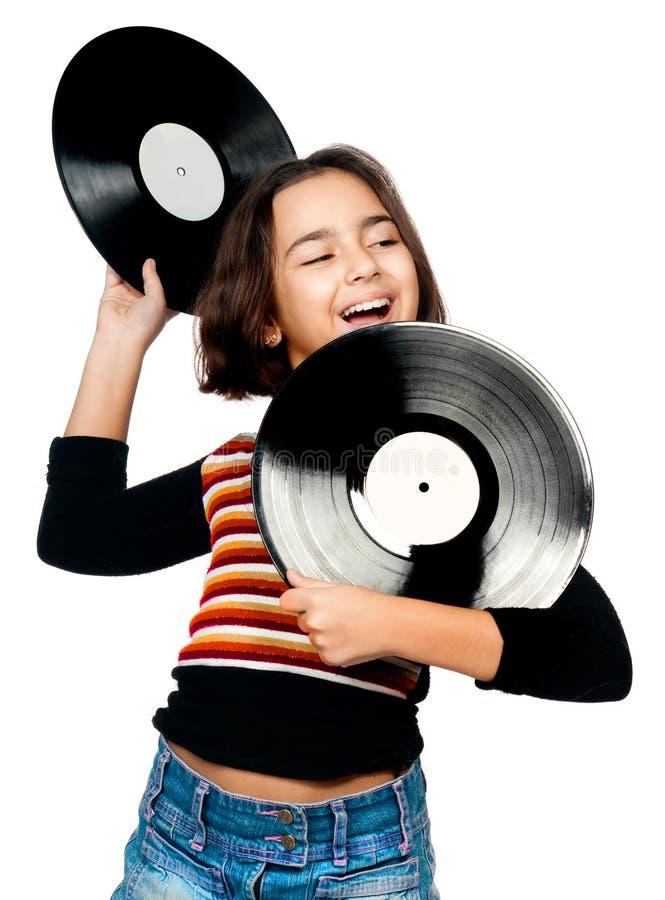 Ragazza con le zolle musicali fotografia stock libera da diritti