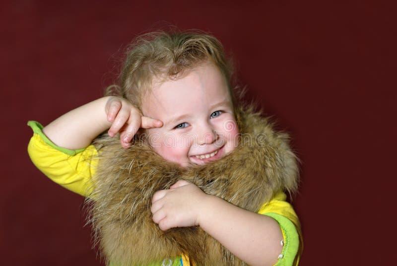 Ragazza con pelliccia fotografia stock libera da diritti