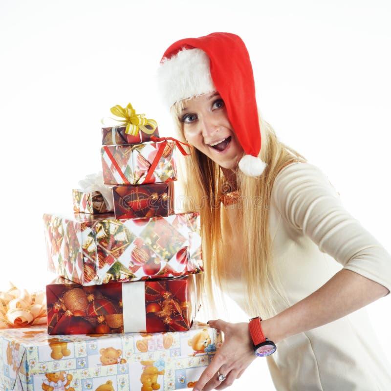 Ragazza con regali di Natale fotografie stock