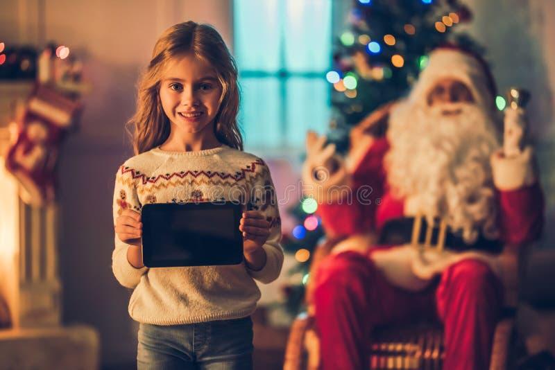 Ragazza con Santa Claus fotografia stock