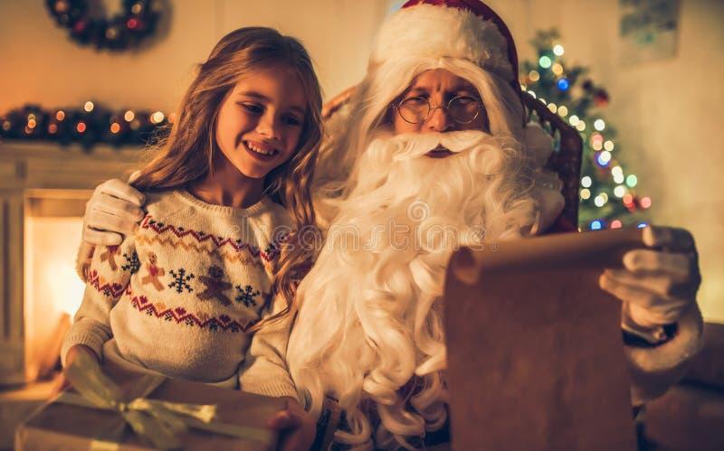 Ragazza con Santa Claus immagine stock libera da diritti