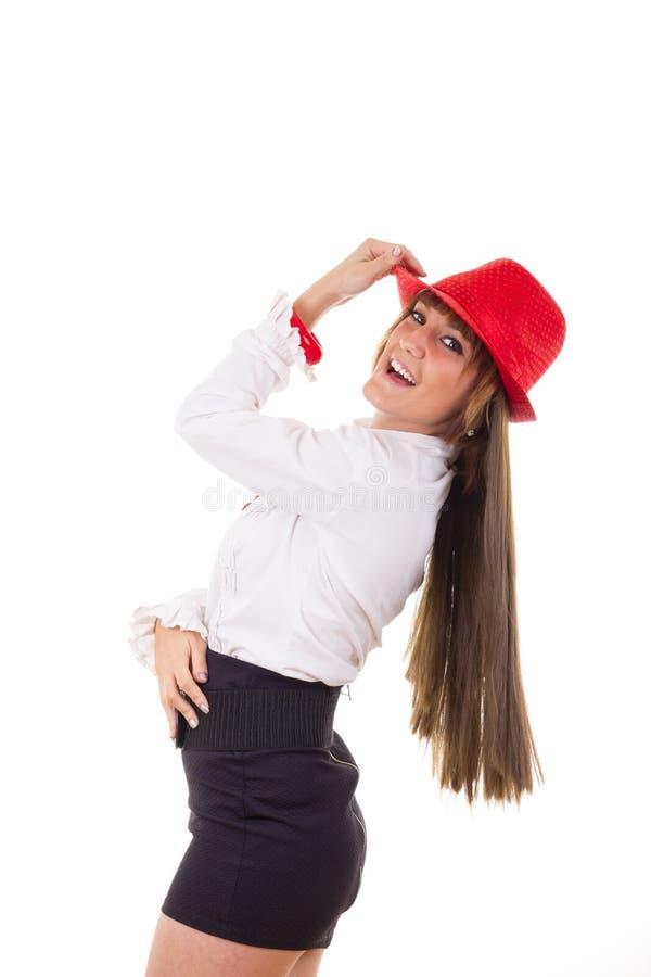 Ragazza con sorridere rosso del cappello immagine stock libera da diritti