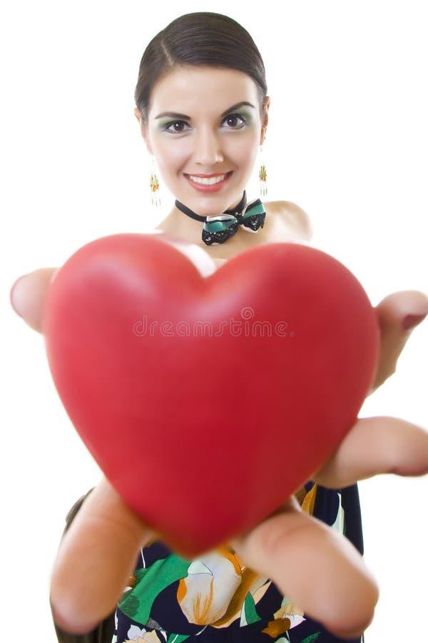 Ragazza con un cuore immagine stock