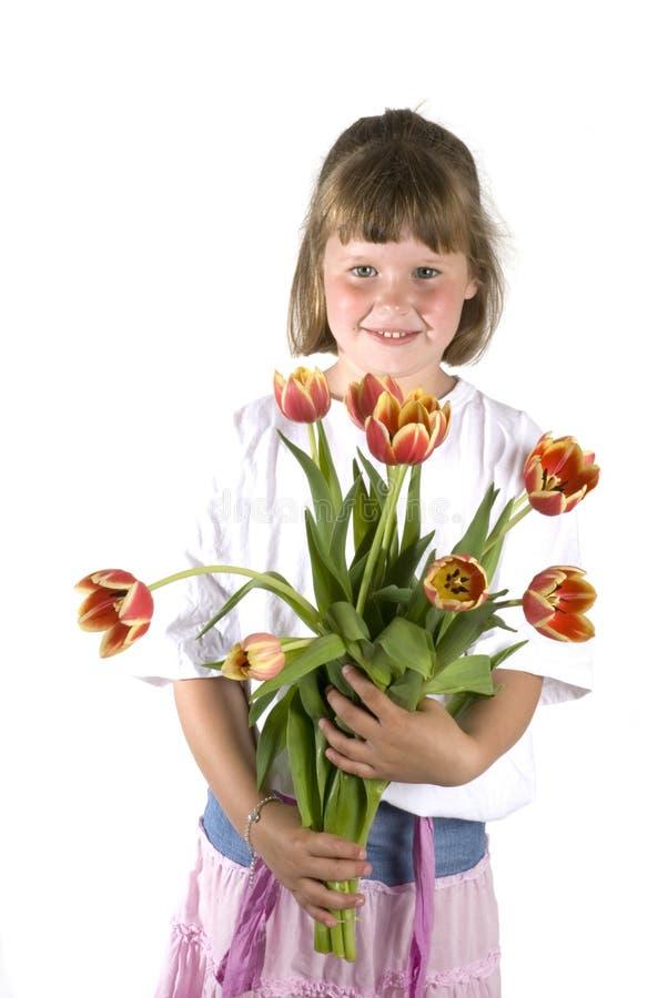 Ragazza con un fiore-regalo fotografia stock