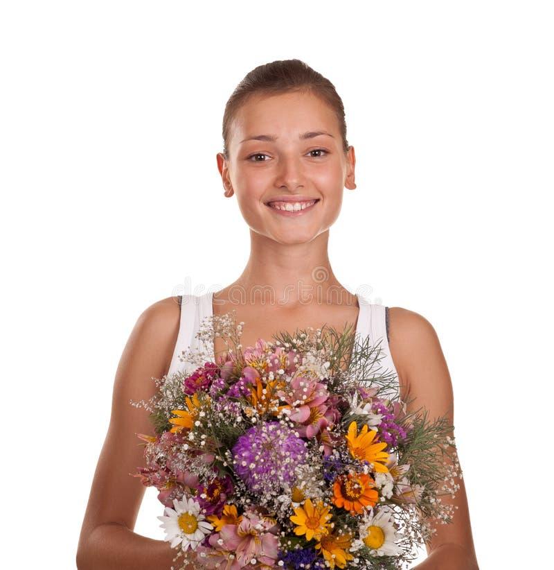 Ragazza con un mazzo di fiori immagini stock libere da diritti