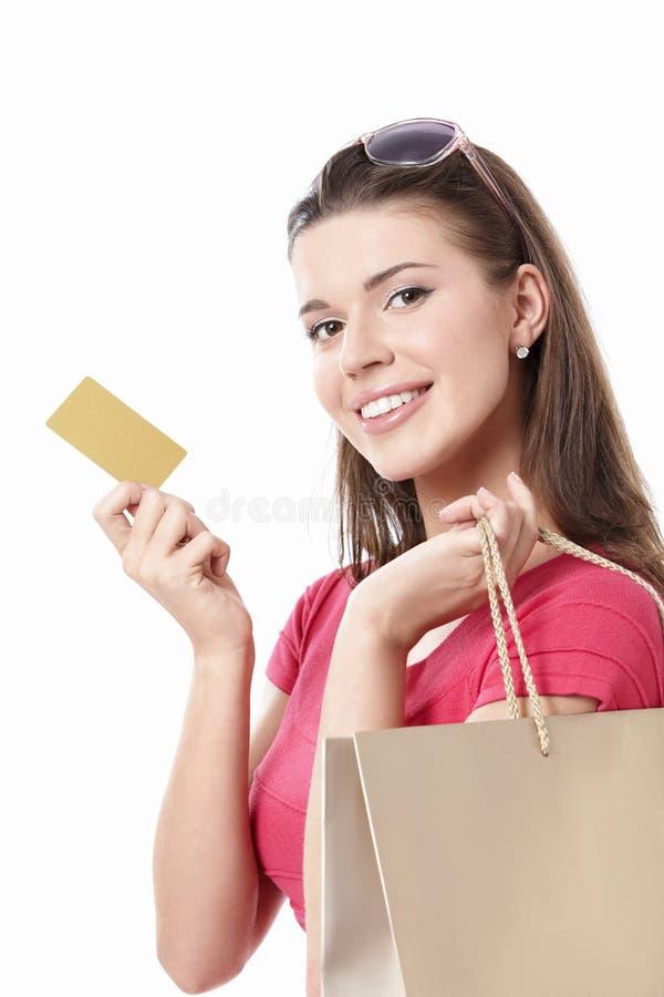 Ragazza con una carta di credito immagini stock