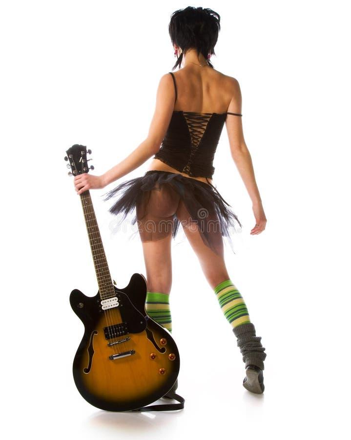 Ragazza con una chitarra immagine stock