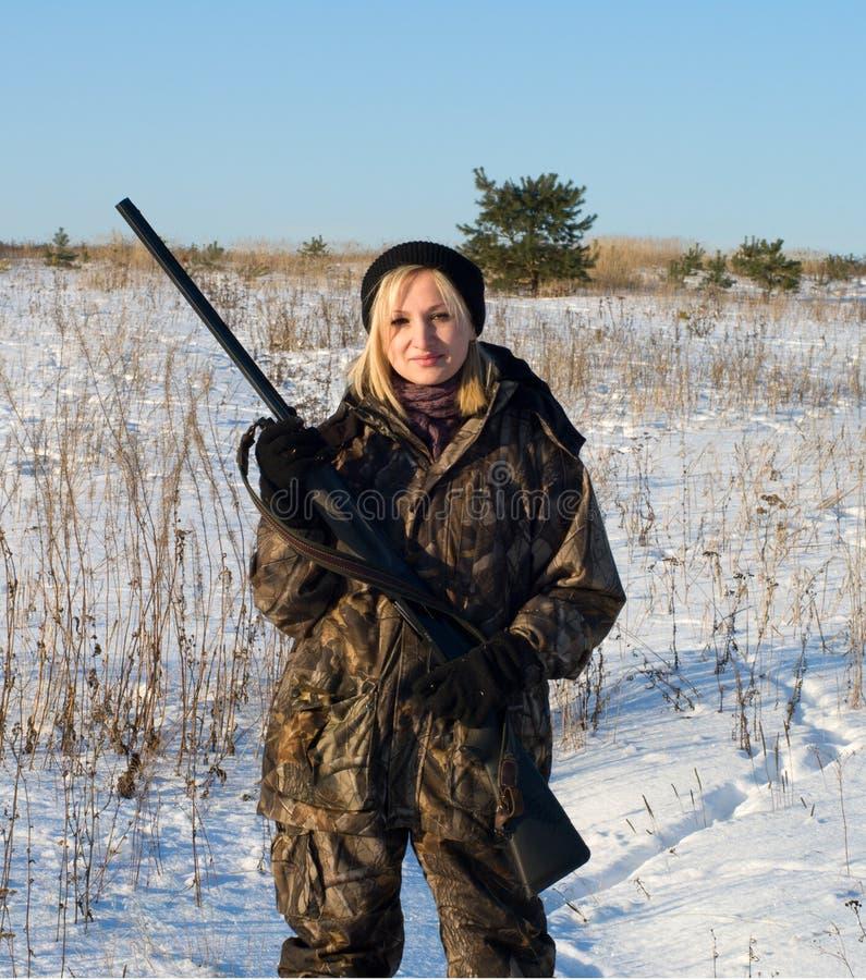 Ragazza con una pistola. fotografia stock libera da diritti