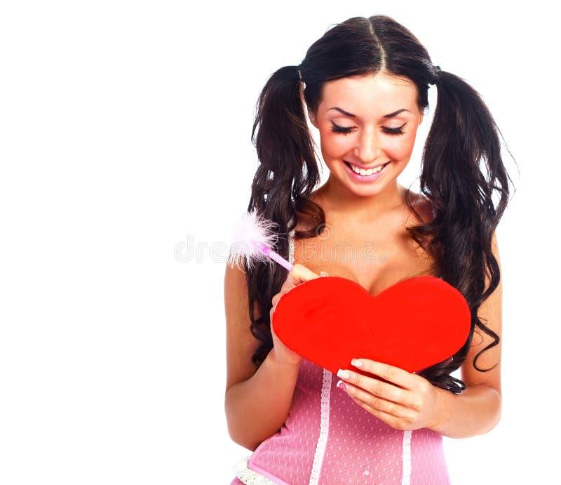 Ragazza con una scheda del biglietto di S. Valentino immagini stock libere da diritti