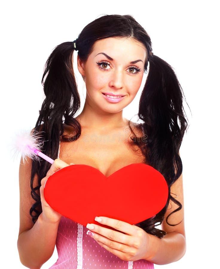 Ragazza con una scheda del biglietto di S. Valentino fotografie stock libere da diritti