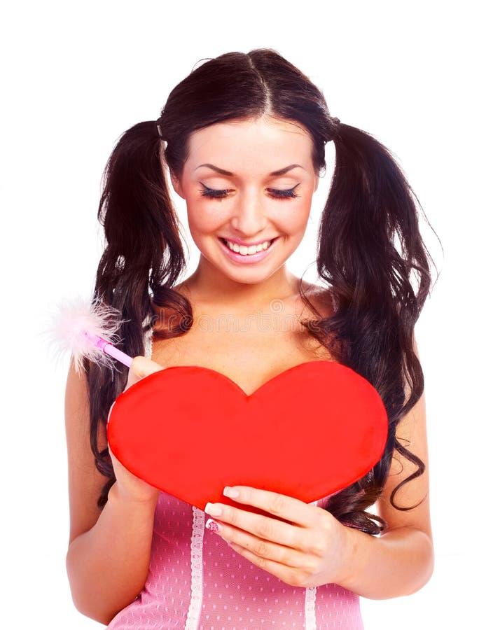 Ragazza con una scheda del biglietto di S. Valentino immagine stock