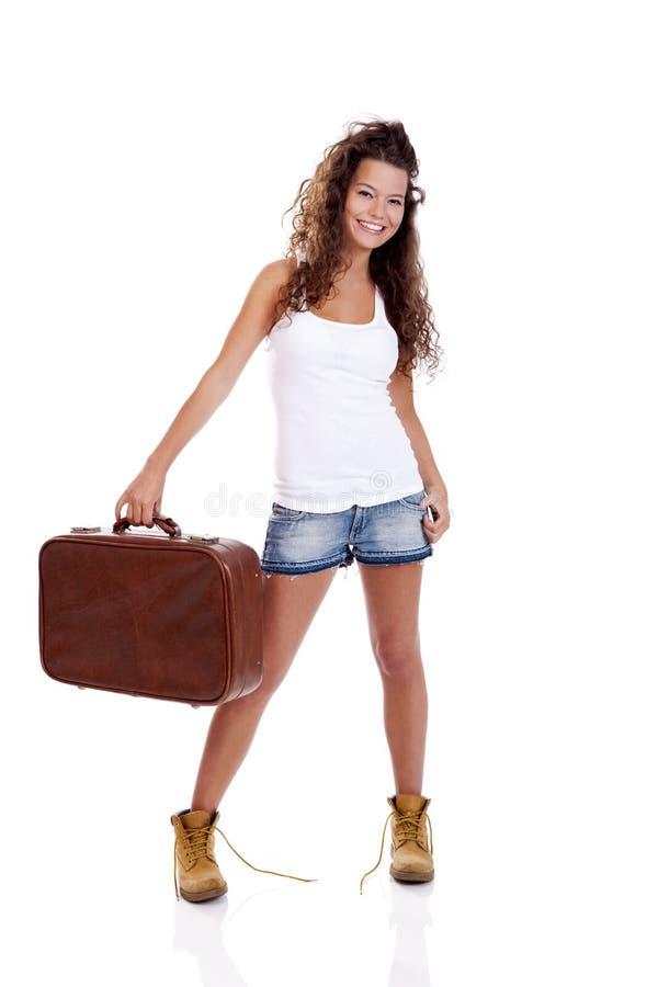 Ragazza con una valigia fotografie stock libere da diritti