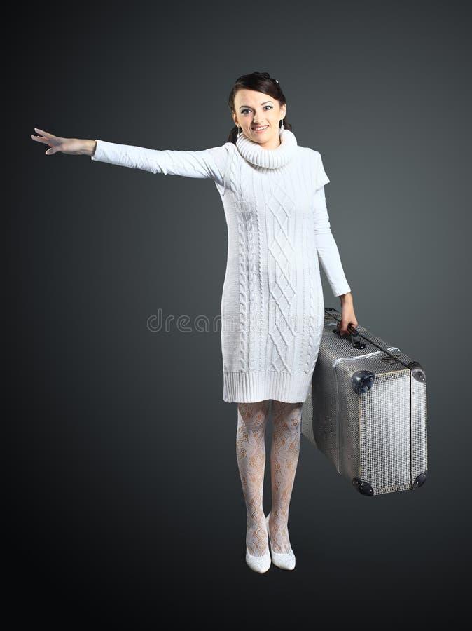 Ragazza con una valigia in sua mano immagine stock - Colorazione immagine di una ragazza ...