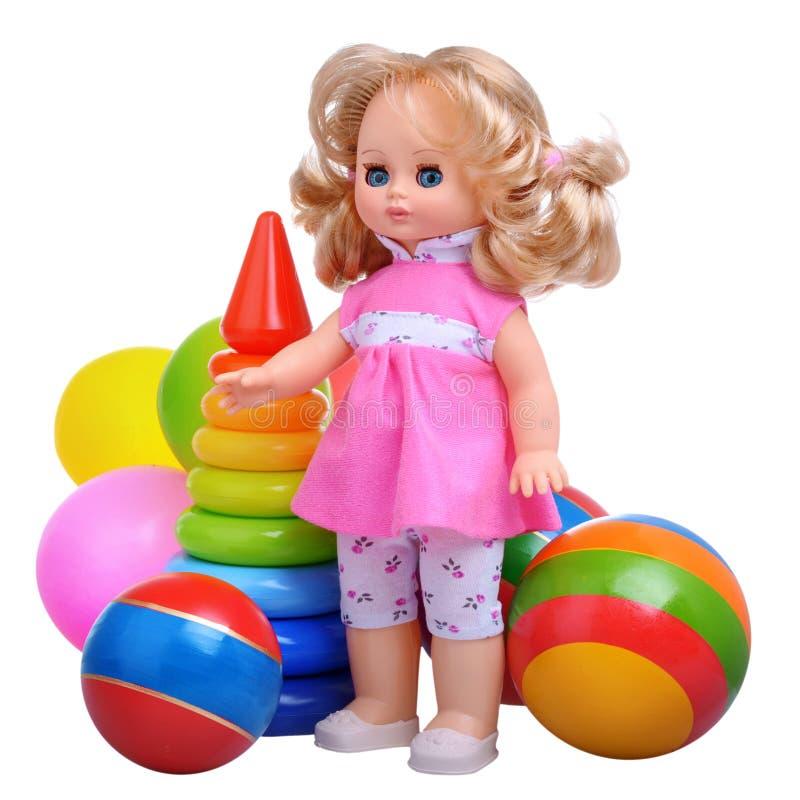 Ragazza d'annata con i giocattoli fotografia stock
