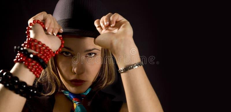 Ragazza d'avanguardia con il cappello fotografia stock libera da diritti