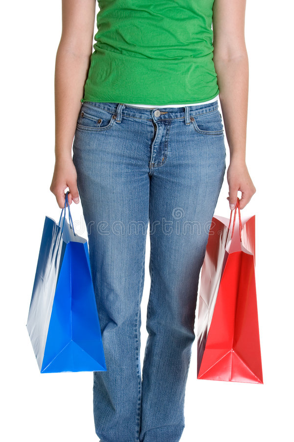 Ragazza dei sacchetti di acquisto immagine stock libera da diritti