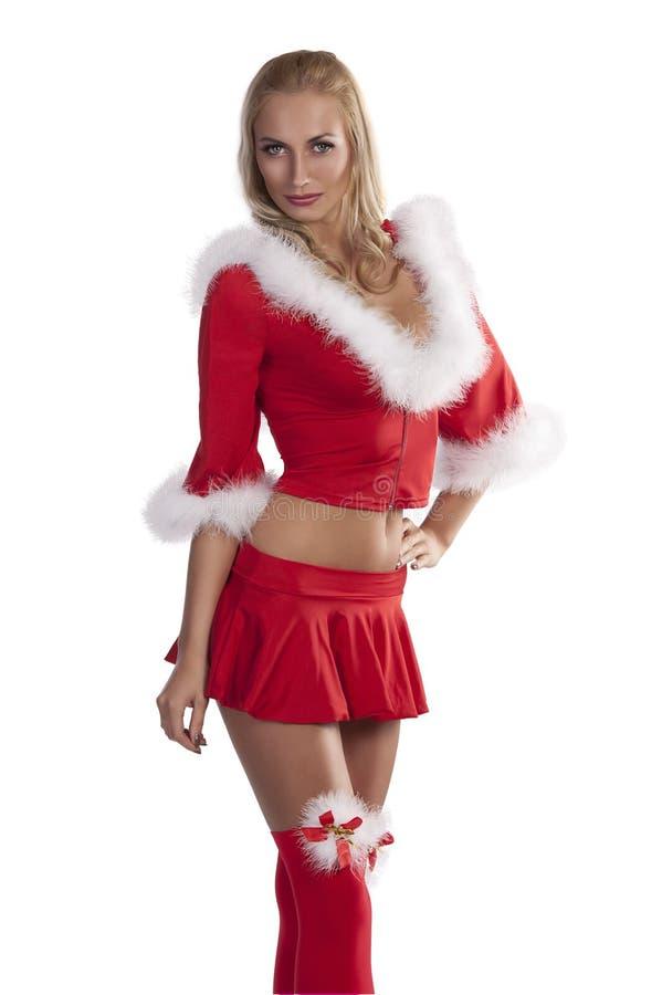 Ragazza del Babbo Natale nelle calze rosse del partito fotografia stock