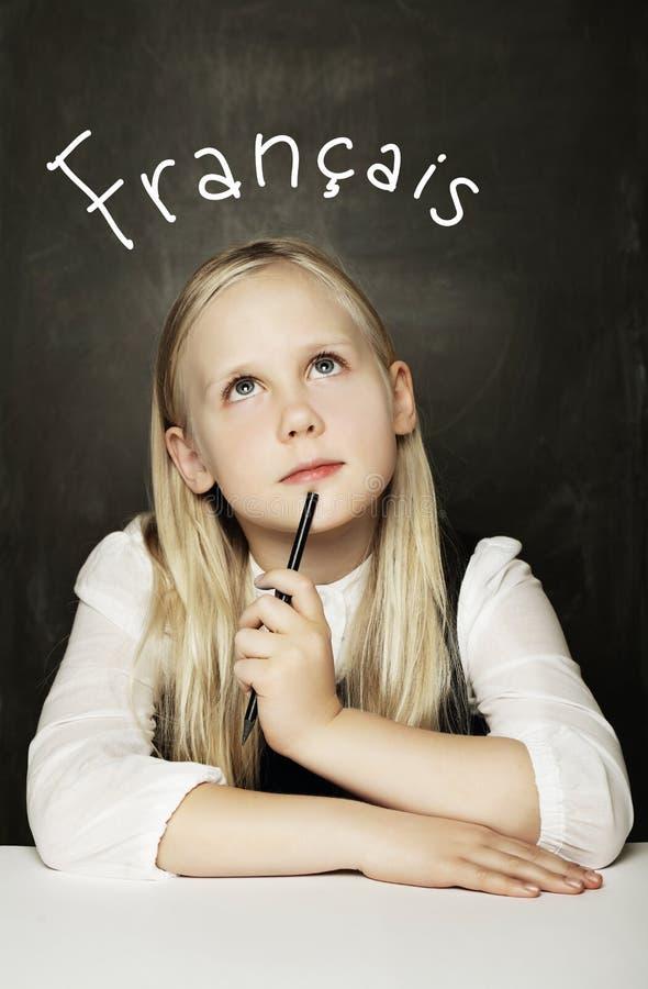 Ragazza del bambino che impara il francese fotografia stock libera da diritti