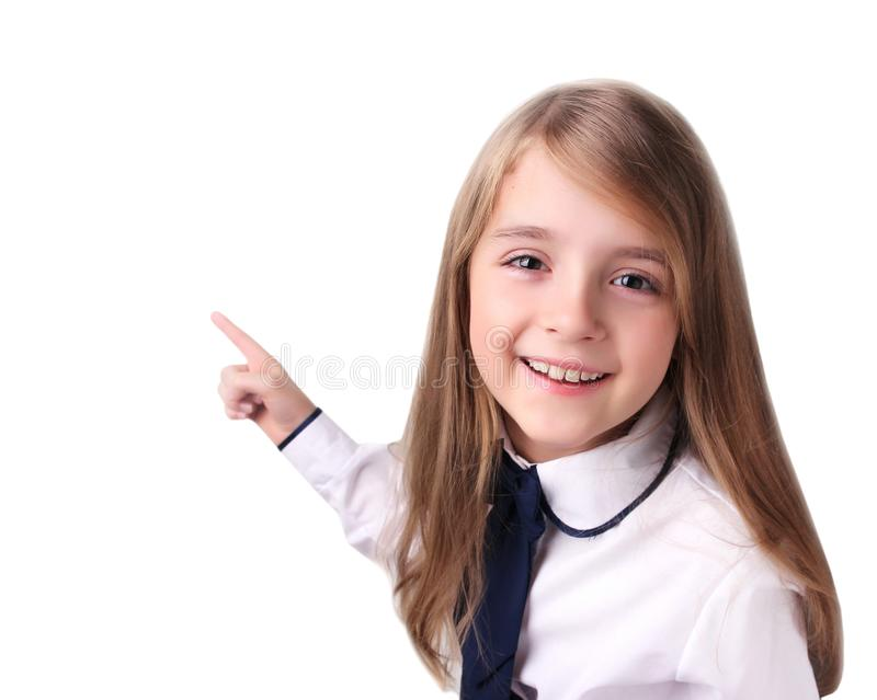 Ragazza del bambino che indica sullo spazio vuoto bianco fotografia stock libera da diritti