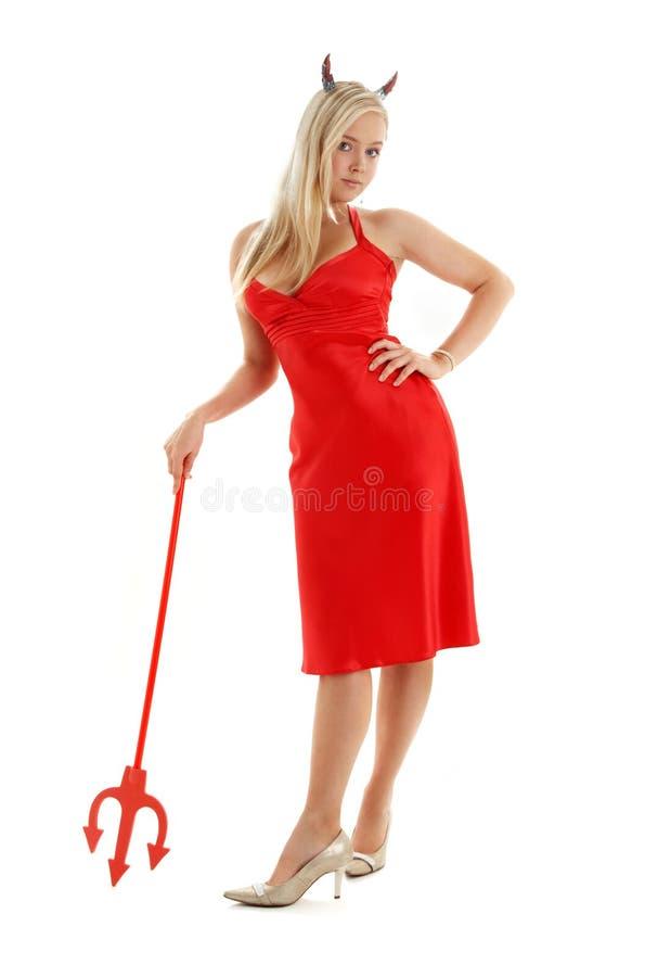 Ragazza del diavolo rosso in vestito operato fotografia stock libera da diritti