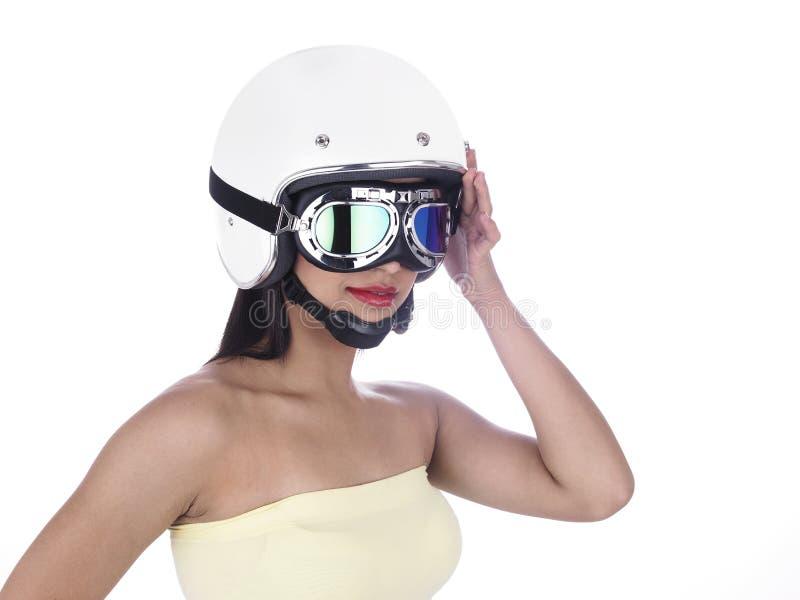 Ragazza del motociclista in un casco bianco immagine stock