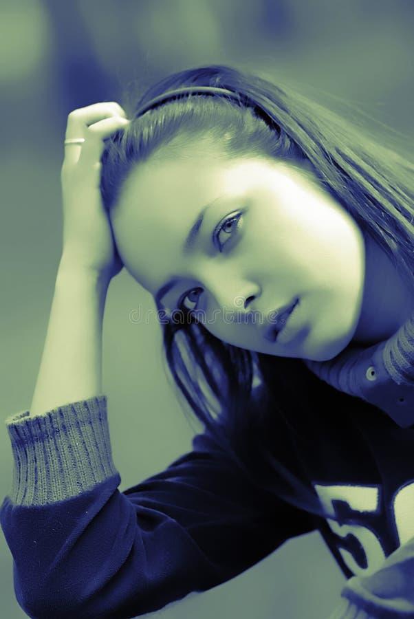 Ragazza del ritratto, blu fotografia stock