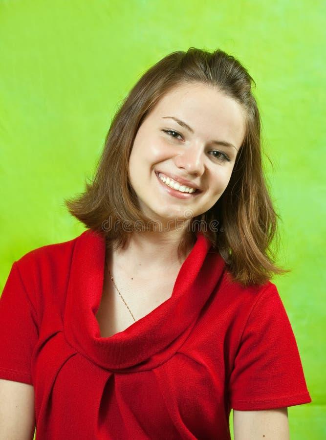 Ragazza del ritratto in vestito rosso fotografia stock