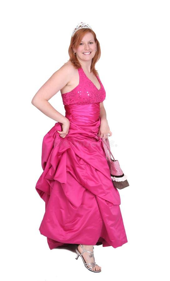 Ragazza del vestito da colore rosa caldo immagini stock