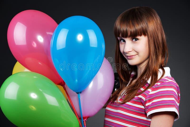 Ragazza dell'adolescente con gli aerostati eterogenei fotografia stock libera da diritti